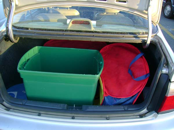 Large green box and two laundry bags in my Accord
