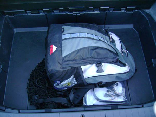 The hidden compartment in the Prius trunk with my backpack for scale