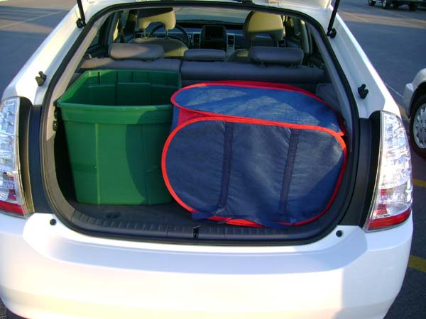 Prius with a large box and two laundry bags