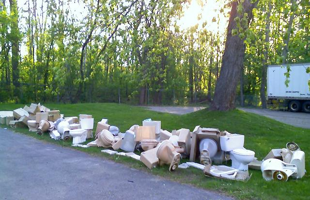 Old toilets on the lawn after one day of upgrades