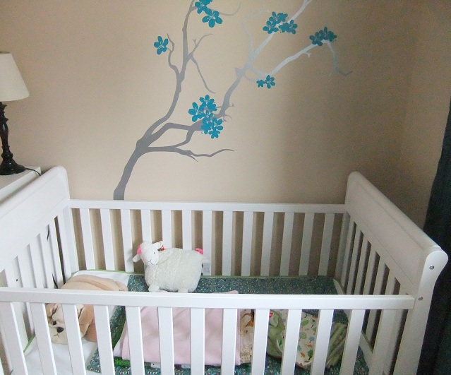 The crib is assembled and the wall decals up.