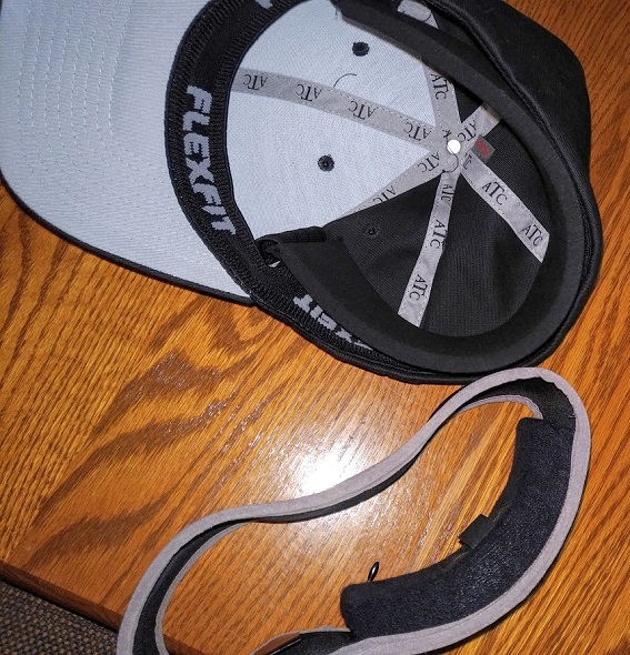 A Goldline headband and Ice Halo Pro-Hat side-by-side on a table.