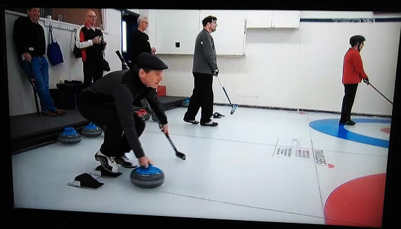A picture of TV showing Curling Day in Canada with me kind of fuzzy but totally there on the ice.