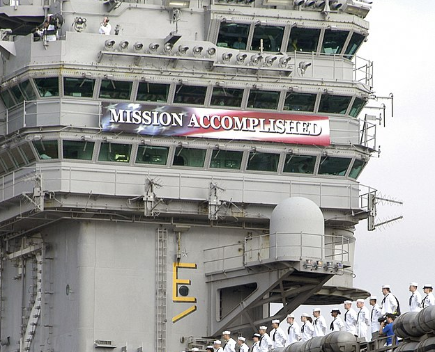 Mission Accomplished, banner on USS Abraham Lincoln, original public domain via Wikimedia